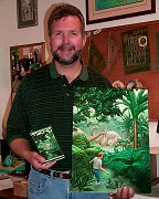 Richard Courtney holds the cover art that he painted for the book